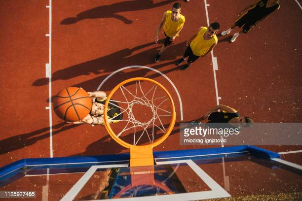 scoring with slam dunk - taking a shot sport stock pictures, royalty-free photos & images