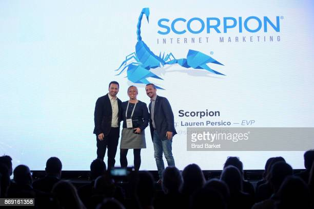 Scorpion EVP Lauren Persico accepts the Innovative Partner of the Year award on behalf of Scorpion from Yext EVP of Partner Jonathan Cherins and Yext...