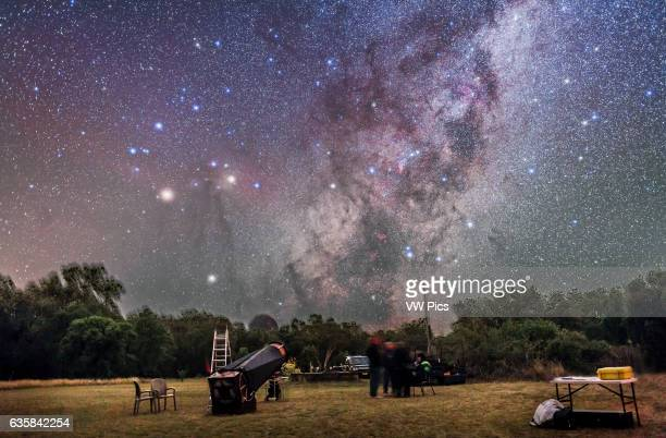 Scorpius rising over a telescope and observers at the annual OzSky Star Party in Coonabarabran NSW Australia on April 5 2016 Mars is the bright...