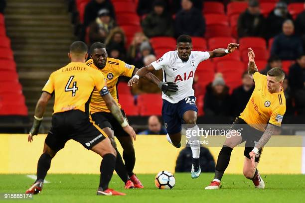 Scot Bennett Frank Nouble and Joss Labadie of Newport County try and tackle Tottenham Hotspur's Serge Aurier during the FA Cup Fourth Round replay...