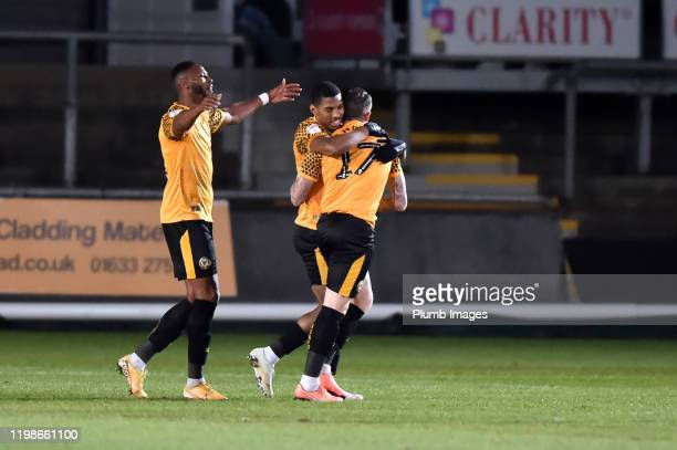 Scot Bennett of Newport County celebrates with team mates after putting his team 10 ahead during the Leasingcom quarter final match between Newport...