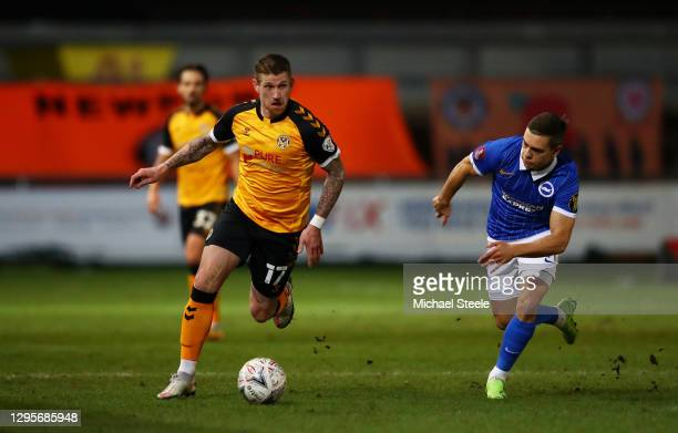 Scot Bennett of Newport County runs with the ball under pressure from Leondro Trossard of Brighton and Hove Albion during the FA Cup Third Round...
