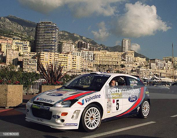 Scot Colin McRae and codriver Nicky Grist in a Ford leave the start 20 January 2000 in Monaco of the Monte Carlo Rally