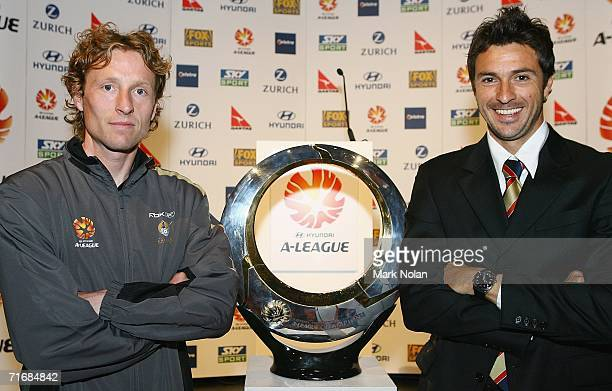 Scot Gemmill of the New Zealand Knights FC and Paul Okon of the Newcastle United Jets pose beside the ALeague trophy during the ALeague Season...