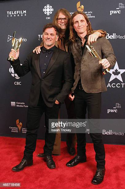 Scot McFadyen Reginald Harkema and Sam Dunn pose in the press room at the 2015 Canadian Screen Awards at the Four Seasons Centre for the Performing...