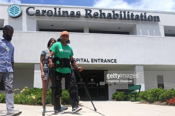 Scot Mills walks outside the Carolinas Rehabilitation facility in his electronic exoskeleton on June 5 2017 His fiance Tonja Granthan and Ryan Medas...