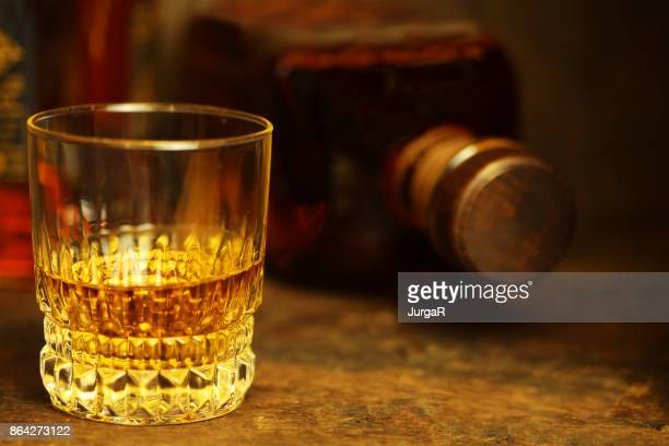 Scotch whiskey on a rustic wooden table