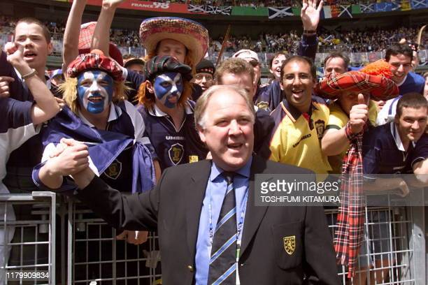 Scotish coach Craig Brown salutes Scotish supporters 10 June at the Stade de France in Saint Denis before the opening ceremony of the 1998 Soccer...
