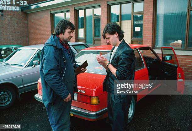 Scotland and Arsenal striker Charlie Nicholas signs an autograph for a fan in May 1983 in Glasgow Scotland