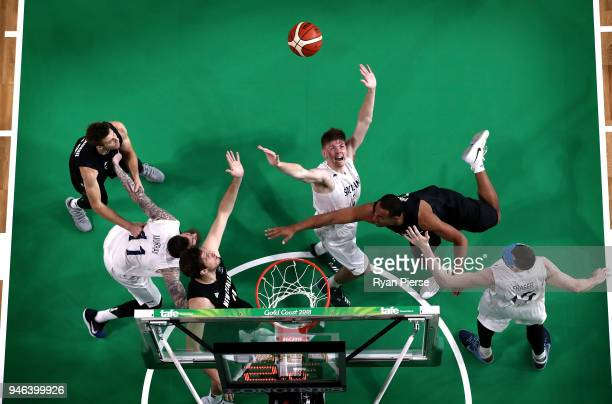 Scotland and New Zealand players contest the ball during Men's Bronze Medal Basketball Game between New Zealand and Scotland on day 11 of the Gold...