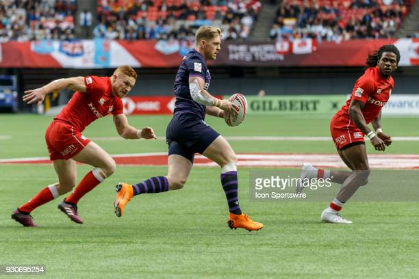 Scotland ball carrier looks to split Canada defenders during Game Canada vs Scotland Challenge Trophy QF1 match at the Canada Sevens held March 1011...