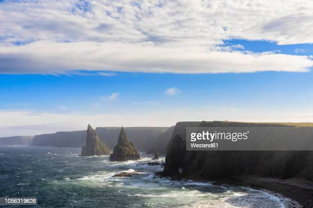 uk, scotland, caithness, coast of duncansby head, duncansby stacks - stack rock stock pictures, royalty-free photos & images