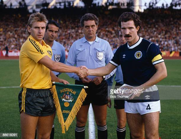 Scotland captain Graeme Souness and Australian captain John Kosmina shake hands prior to the start of the Australia v Scotland World Cup Qualifier in...