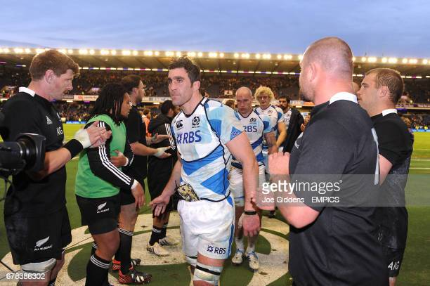 Scotland captain Kelly Brown leaves the field dejected at the end of the game