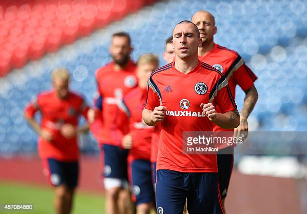 Scotland captain Scott Brown takes part in a training session ahead of their UEFA Euro 2016 qualifier against Germany at Hampden Park on September 06...