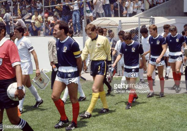 Scotland captain Willie Miller leads out the team before the FIFA World Cup Group E match between Scotland and Uruguay at the Estadio Neza 86 on June...