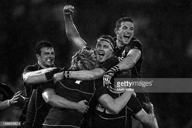 Scotland celebrate their victory during the International Test match between the Australian Wallabies and Scotland at Hunter Stadium on June 5 2012...