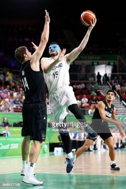 Scotland center Alasdair Fraser and New Zealand center Robert Loe compete during the Men's Bronze Medal Basketball Game between Scotland and New...
