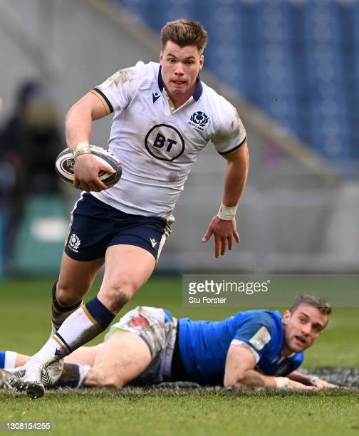 Scotland centre Huw Jones makes a break during the Guinness Six Nations match between Scotland and Italy at Murrayfield on March 20, 2021 in...