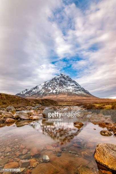uk, scotland, clouds over river coupall with buachaille etive mor mountain in background - glen etive mor stock pictures, royalty-free photos & images