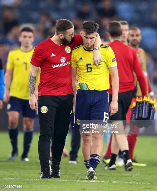 Scotland coach James McFadden consoles Kieran Tierney after the UEFA Nations League Group C1 match at the Sammy Ofer Stadium, Haifa.