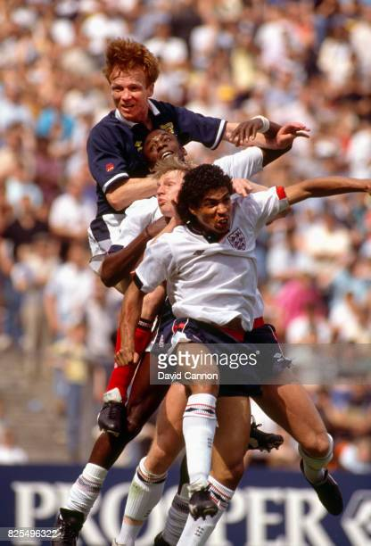 Scotland defender Alex McLeish outjumps England players John Fashanu Stuart Pearce and Des Walker during the 1989 Rous Cup International at Hampden...