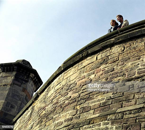 Scotland, Edinburgh Castle, couple standing on battlement
