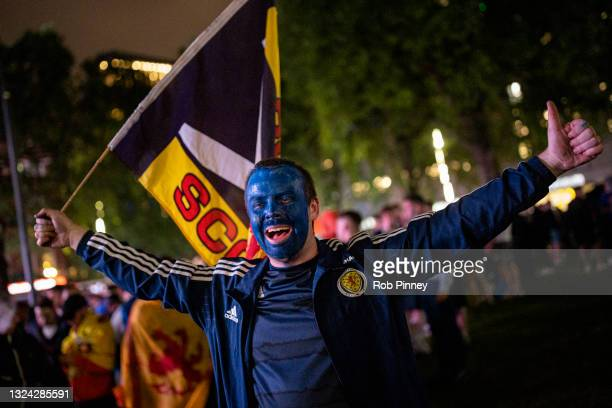 Scotland fan celebrates in Leicester Square after the England v Scotland game ended in a 0-0 draw on June 18, 2021 in London, England. England v...