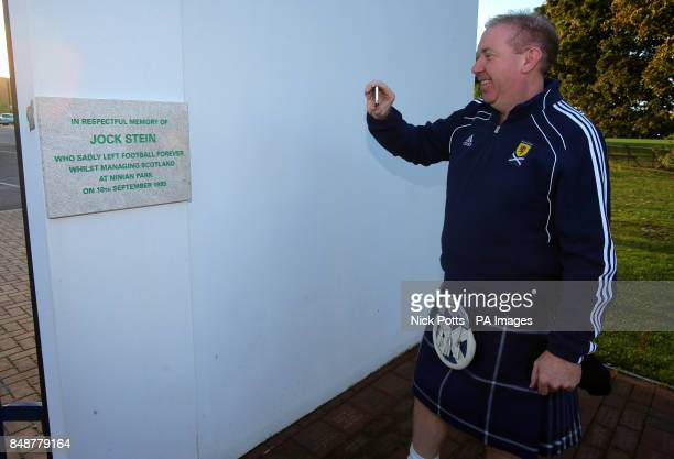 Scotland fan Gary Holden at the old Ninian Park Gates with the plaque in memory of former Scotland Manager Jock Stein prior to the 2014 FIFA World...