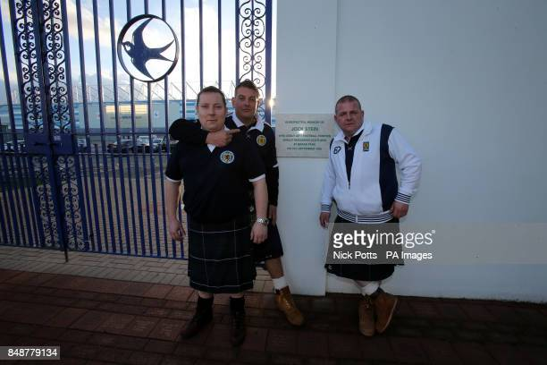 Scotland fan Gordon Young and friends Graham and Tony at the old Ninian Park Gates with the plaque in memory of former Scotland Manager Jock Stein...