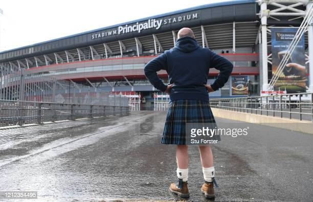 Scotland fan in a kilt is pictured outside a deserted Principality Stadium after the 2020 Guinness Six Nations match between Wales and Scotland at...