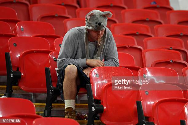 Scotland fan is unwell after the FIFA 2018 World Cup qualifying match between England and Scotland at Wembley Stadium on November 11 2016 in London...