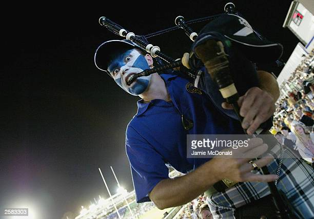 Scotland fan plays his bagpipes during the Rugby World Cup Pool B match between Scotland and Japan at Dairy Farmers Stadium October 12 2003 in...