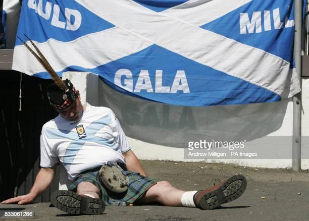 Scotland fan takes a nap in Torshavn, Faroe Islands.
