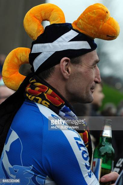 A Scotland fan wears a Loch Ness Monsterthemed hat ahead of the Six Nations international rugby union match between Scotland and Wales at Murrayfield...