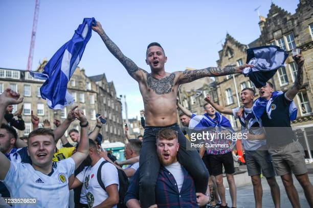 Scotland fans are seen cheering in the Grassmarket prior to the game against England on June 17, 2021 in Edinburgh, Scotland. England V Scotland is...