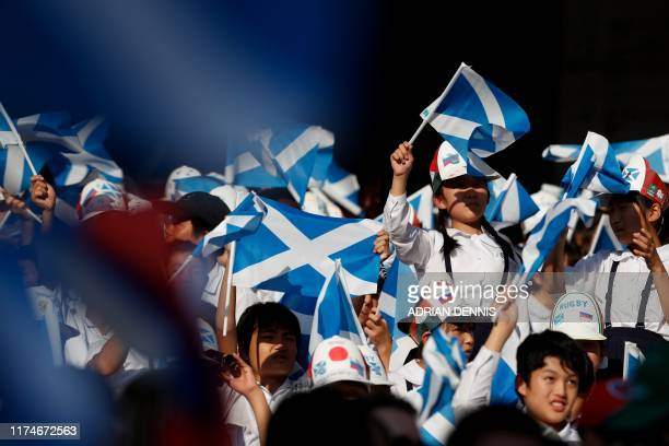 Scotland fans cheer on the team during the Japan 2019 Rugby World Cup Pool A match between Scotland and Russia at the Shizuoka Stadium Ecopa in...