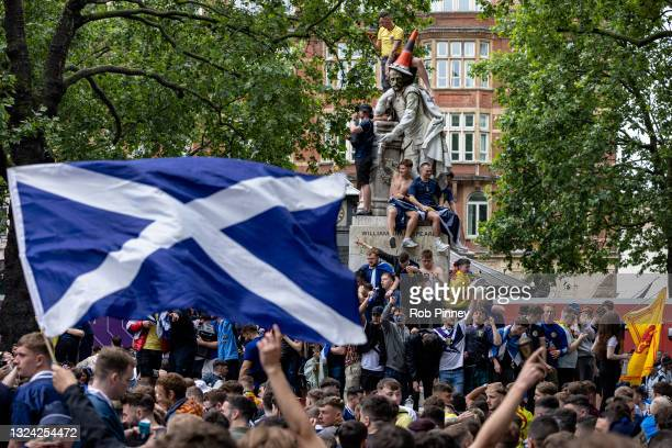 Scotland fans climb a statue of William Shakespeare in Leicester Square on June 18, 2021 in London, England. England v Scotland is not only the...