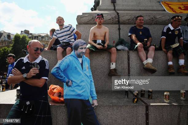 Scotland fans gather in Trafalgar Square ahead of their international friendly match against England tonight on August 14 2013 in London England...