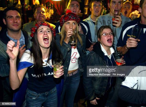 Scotland fans in the Horseshoe bar, Glasgow watching the Euro 2004 play-off second-leg match between Scotland and the Netherlands being held at the...