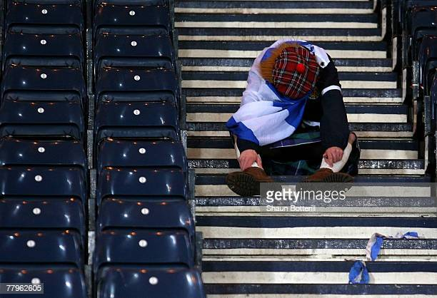 Scotland fans look dejected after the UEFA Euro 2008 Qualifying match between Scotland and Italy at Hampden Park on November 17 2007 in Glasgow...