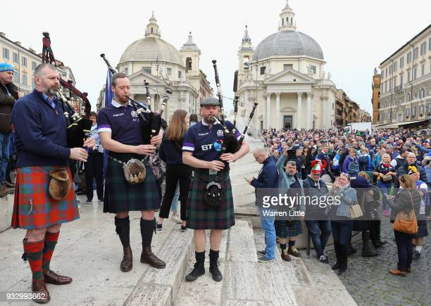 Scotland fans play the bagpipes at Piazza del Popolo prior to the NatWest Six Nations match between Italy and Scotland at Stadio Olimpico on March 17...