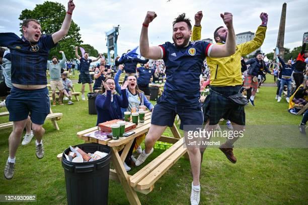Scotland fans react as their team scorein the Euro 2020 game against Croatia on June 22, 2021 in Glasgow, Scotland. Scotland play Croatia hoping to...