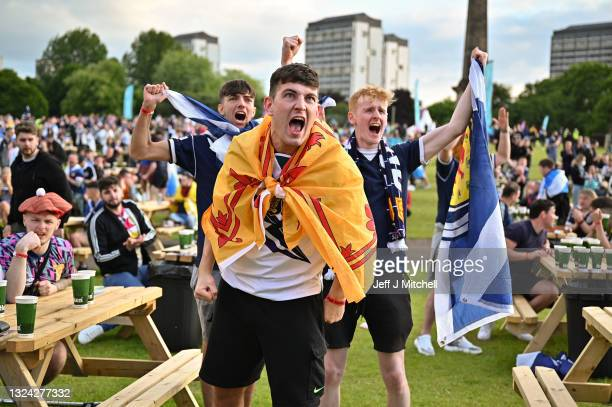 Scotland fans react as they support their team in the Euro 2020 game against England on June 18, 2021 in Glasgow, Scotland. England V Scotland is not...