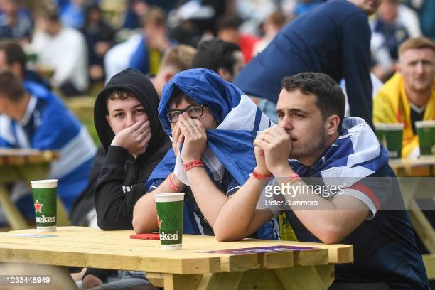 Scotland fans react while watching the match at the fanzone outside the stadium on June 14, 2021 in Glasgow, Scotland. Scotland take on the Czech...
