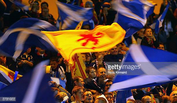Scotland fans wave flags during the Euro 2004 Play-off, first leg match between Scotland and Holland at Hampden Park on November 15, 2003 in Glasgow,...