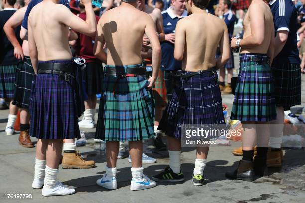 Scotland fans wearing kilts gather in Trafalgar Square ahead of their international friendly match against England tonight on August 14 2013 in...