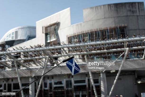 Scotland flag in a car antenna in front of the Scottish Parliament Building Edinburgh is a city with a population of 500000 in 2017 it the capital...