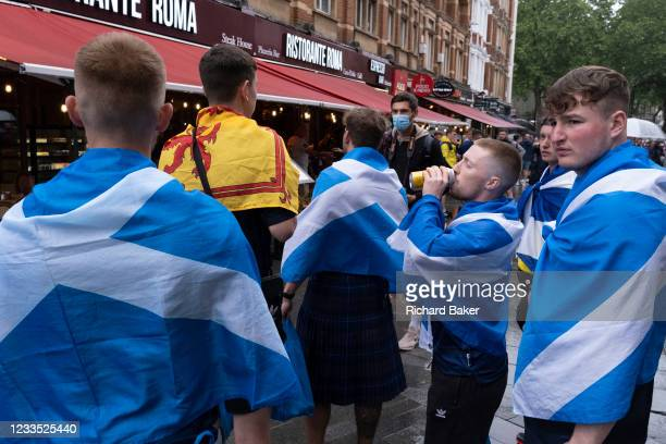 Scotland football supporters gather in the rain near London's Leicester Square before tonight's match between England and Scotland at Wembley, during...