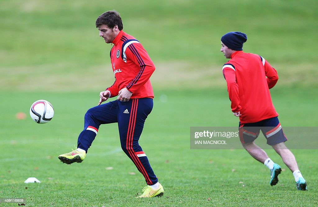 Scotland footballer Chris Martin (L) takes part in a training session at Mar Hall, Bishopton, near Glasgow, in Scotland on November 17, 2014, ahead of their friendly international match against England on November 18, 2014.
